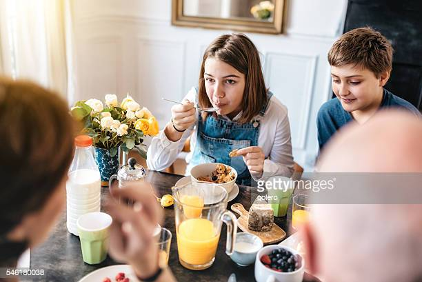 french family having breakfast together
