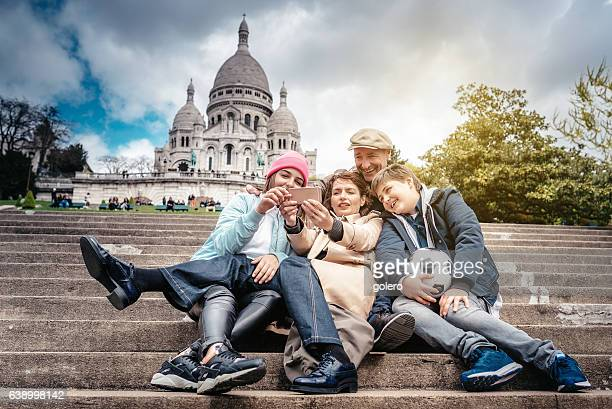 french family taking selfie on monmartre stairs in Paris