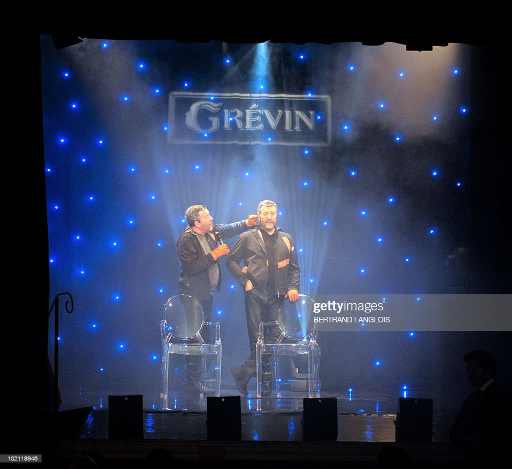 French famous designer Philippe Starck touches his wax likeness at the Grevin wax museum in Paris, on June 15, 2010, during the presentation of his effigy. Starck is the first architect and designer to enter the Grevin.