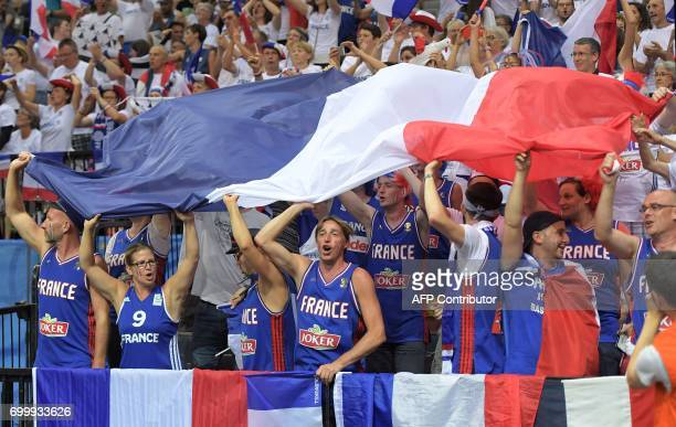 French fans celebrate their victory after the FIBA EuroBasket 2017 women's quarterfinal match between France and Slovakia on June 22 2017 in Prague...