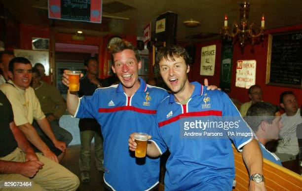 French Fans Charles Bouchez 25 and Arnaud Coeff watch the Euro 2004 group B match between England and France in a bar in Rennes France