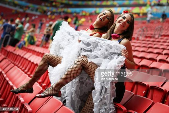 French fans dance a cancan during the 2014 FIFA World Cup Brazil Round of 16 match between France and Nigeria at the Estadio Nacional on June 30 2014...