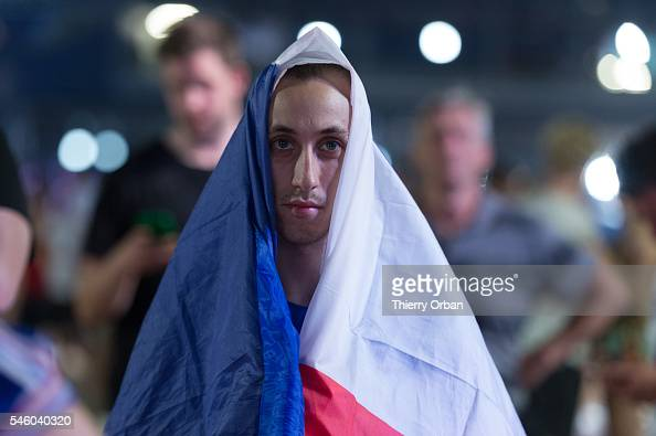 French fans disappointed after the Euro 2016 final football match between Portugal and France in the Eiffel Tower fan zone in Paris on July 10 2016...