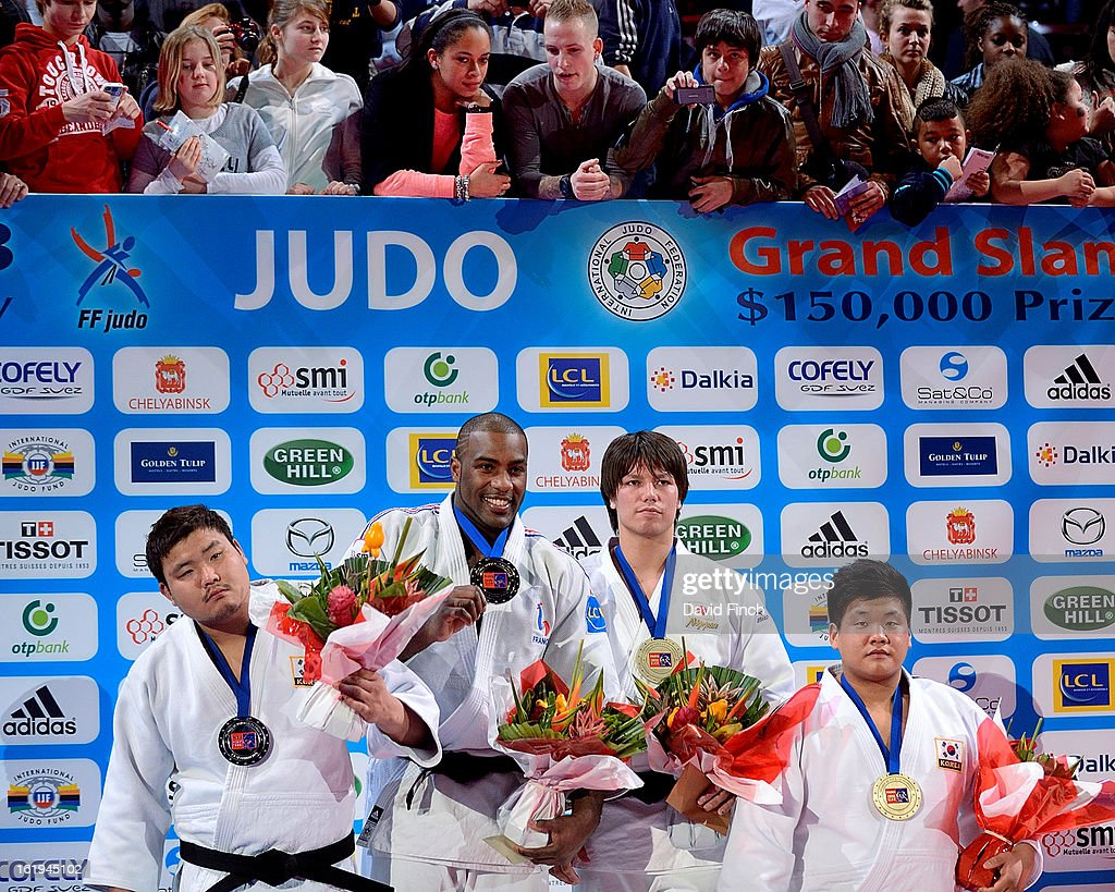 French fans of Riner watch the medal ceremony from the terrace above the podium. Medallists (L-R): Silver: Sung-Min Kim of Korea, Gold: <a gi-track='captionPersonalityLinkClicked' href=/galleries/search?phrase=Teddy+Riner&family=editorial&specificpeople=4114927 ng-click='$event.stopPropagation()'>Teddy Riner</a> of France, Bronzes: Ryu Shichinohe of Japan and Guham Cho of Korea during the Paris Grand Slam on day 2, Sunday, February 10, 2013 at the Palais Omnisports de Paris, Bercy, Paris, France.