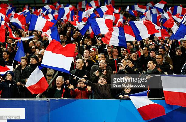 French fans show their support during the International Friendly match between France and Russia held at Stade de France on March 29 2016 in Paris...