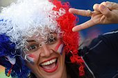 TOPSHOT French fans wait for the start of the Euro 2016 group A football match between Switzerland and France at the PierreMauroy stadium in Lille on...