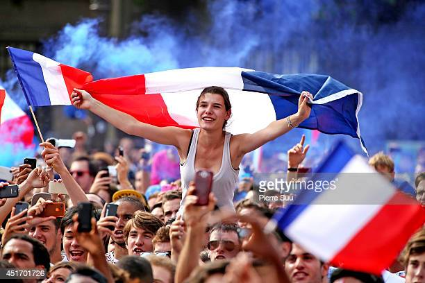 French fans watch the 2014 FIFA World Cup Quarter Final Football Match on a giant screen at the Hotel De Ville also known as the Paris City Hall on...