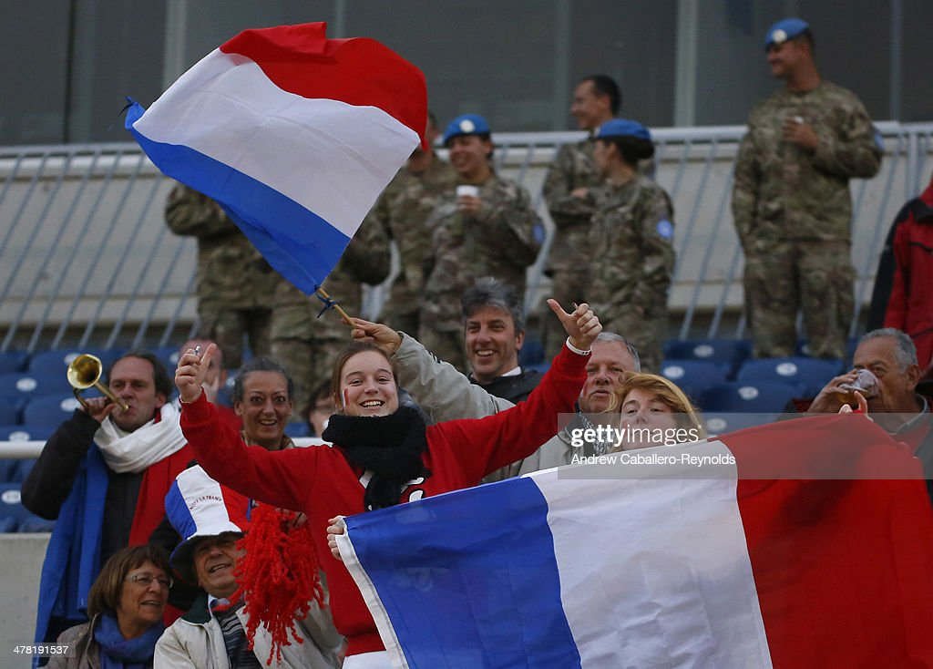 French fans wave flags and sing before the Cyprus cup final between England an France at GSP stadium on March 12, 2014 in Nicosia, Cyprus.