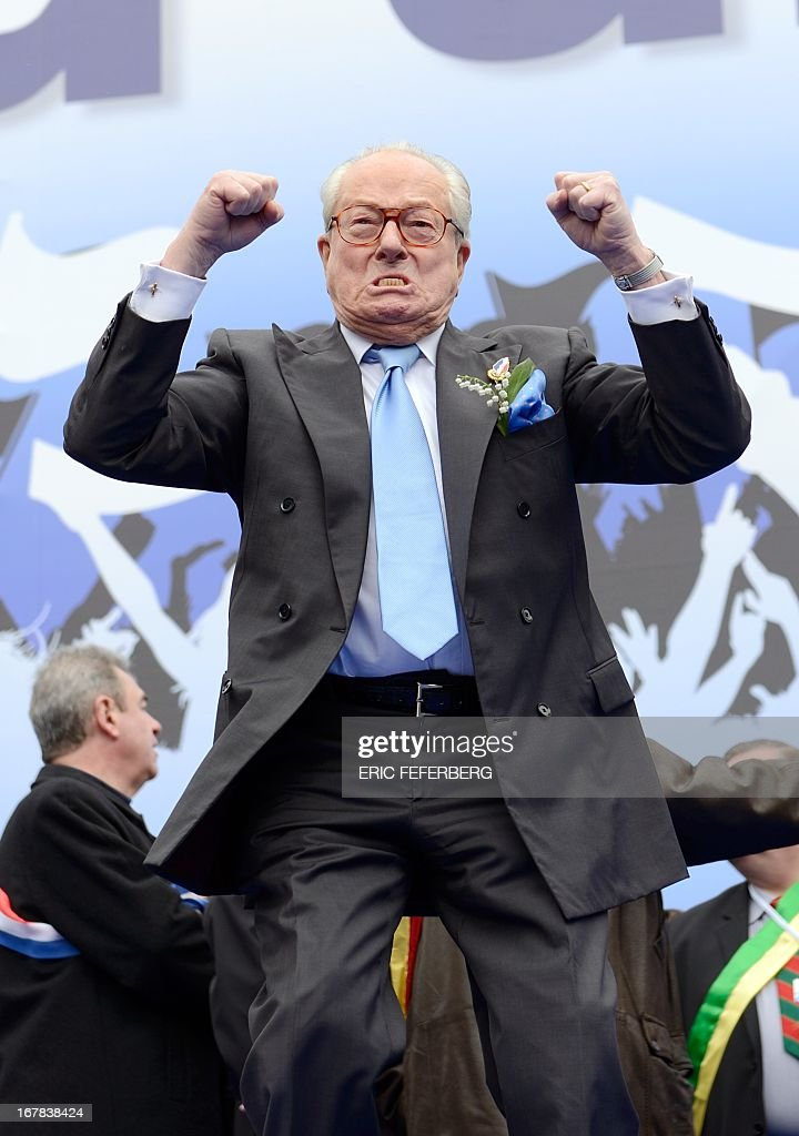French far right Front National (FN) party honnor president Jean-Marie Le Pen gestures as part of the party's annual celebrations of Joan of Arc on May 1, 2013 on Paris' Opera square.