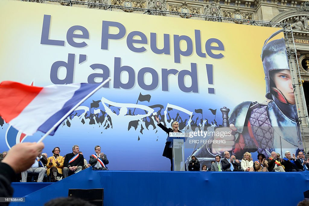 French far right Front National (FN) party president Marine Le Pen delivers a speech, during the party's annual celebrations of Joan of Arc on May 1, 2013 at Paris' Opera square.