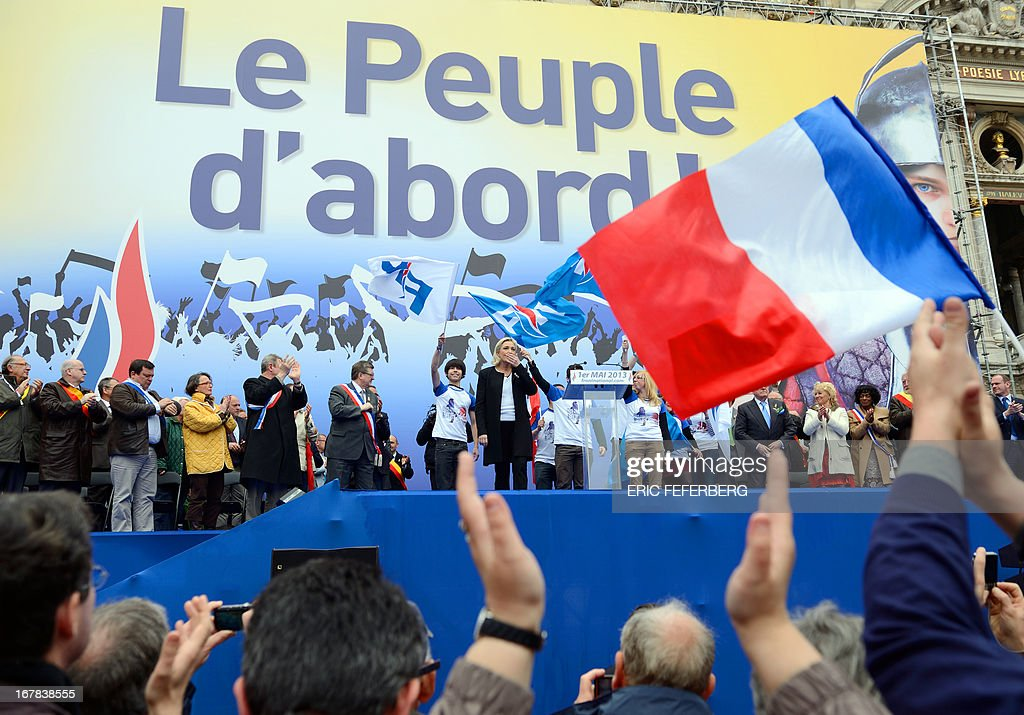 French far right Front National (FN) party president Marine Le Pen gestures after a speech, during the party's annual celebrations of Joan of Arc on May 1, 2013 at Paris' Opera square. AFP PHOTO / ERIC FEFERBERG