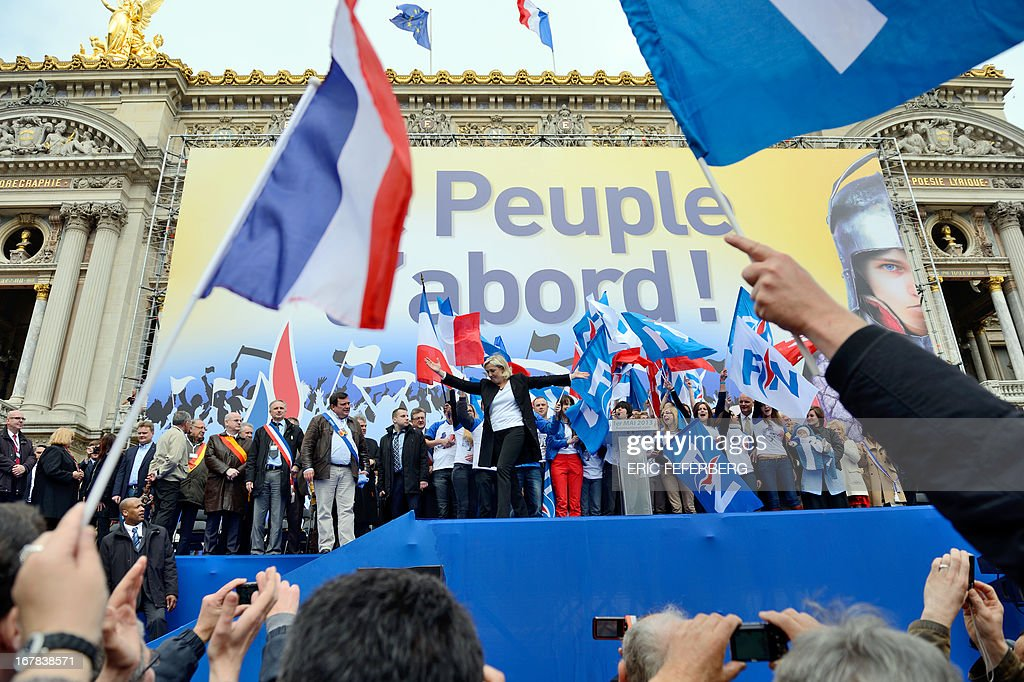 French far right Front National (FN) party president Marine Le Pen gestures at the end of her speech during the party's annual celebrations of Joan of Arc on May 1, 2013 at Paris' Opera square.