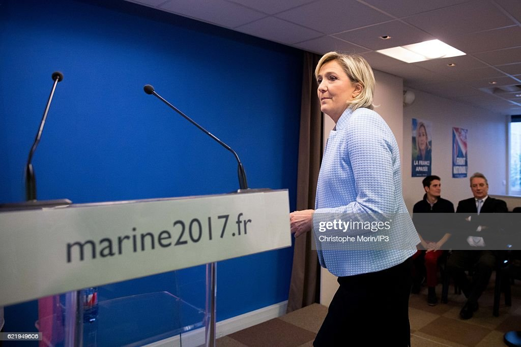 French far right National Front (FN) political party leader Marine Le Pen (C), member of the European Parliament and candidate for the 2017 presidential elections, arrives to hold a press conference at the party headquarters after Donald Trump defeated Democratic presidential nominee Hillary Clinton to become the 45th president of the United States, on November 9, 2016 in Nanterre, France.