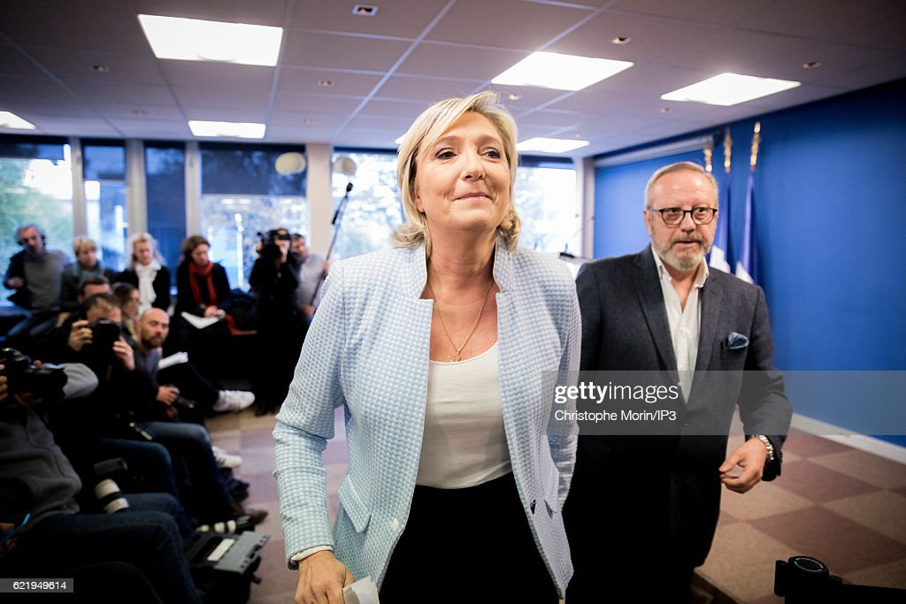 French far right National Front (FN) political party leader Marine Le Pen (C), member of the European Parliament and candidate for the 2017 presidential elections, leaves after holding a press conference at the party headquarters after Donald Trump defeated Democratic presidential nominee Hillary Clinton to become the 45th president of the United States, on November 9, 2016 in Nanterre, France.