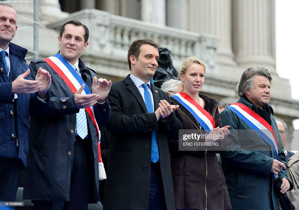 French far right party Front National (FN) (From L) general secretary Steeve Briois, local elected Nicolas Bay, vice-president of the Front National Florian Philippot, deputies Marion Marechal-Le Pen and Gilbert Collard attend the party's annual celebrations of Joan of Arc on May 1, 2013 at Paris' Opera square.