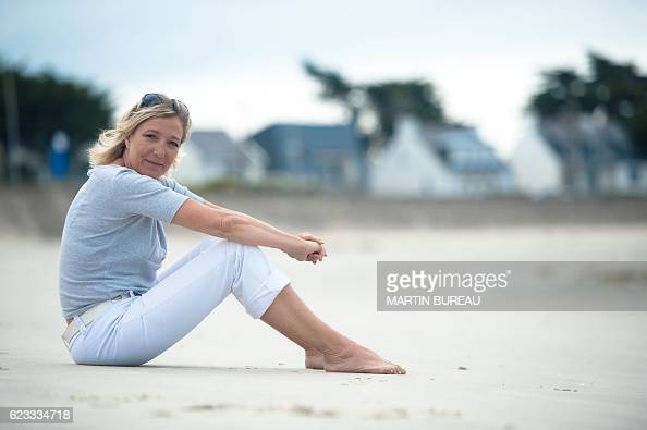 French far right party the National Front's vicepresident Marine Le Pen poses on the beach on July 28 2010 in La TrinitesurMer northern France Marine...