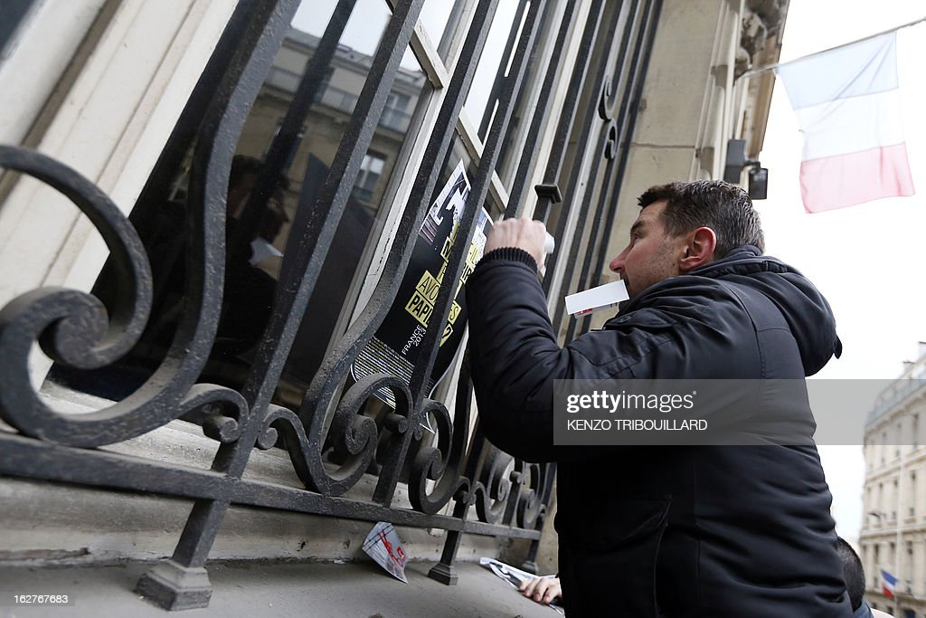 French far-left anti-capitalist NPA party's member and former presidential candidate, Olivier Besancenot takes part with illegal immigrants and militants to a demonstration to call for the legalization of all undocumented immigrants in front of the Interior ministry on February 26, 2013 in Paris.