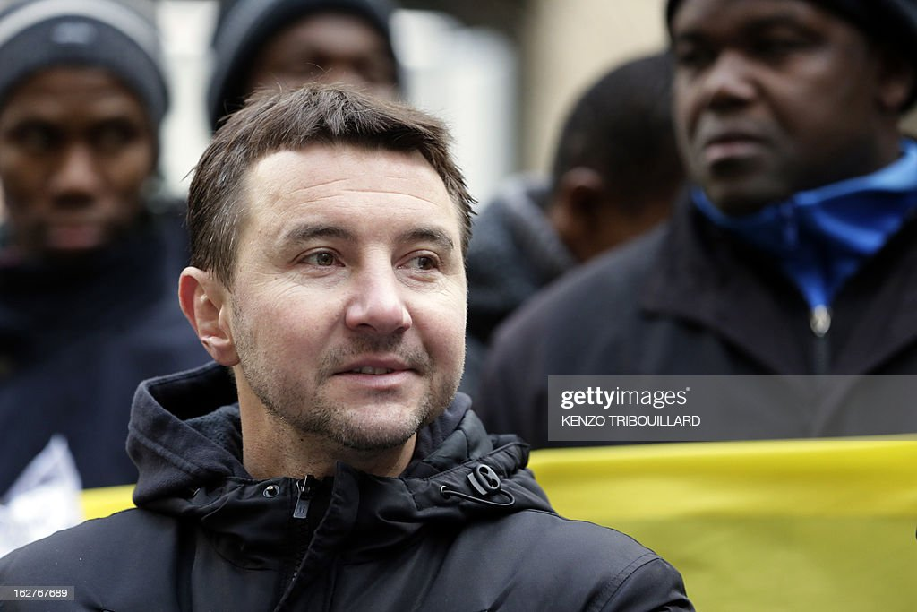 French far-left anti-capitalist NPA party's member and former presidential candidate, Olivier Besancenot takes part with illegal immigrants and militants to a demonstration to call for the legalization of all undocumented immigrants in front of the Interior ministry on February 26, 2013 in Paris. AFP PHOTO KENZO TRIBOUILLARD
