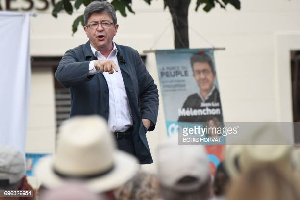 French farleft coalition La France Insoumise leader JeanLuc Melenchon gestures as he speaks during a public meeting in Marseille southern France on...