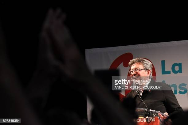 French farleft coalition La France Insoumise leader JeanLuc Melenchon smiles as he delivers a speech after the polls closed during the second round...