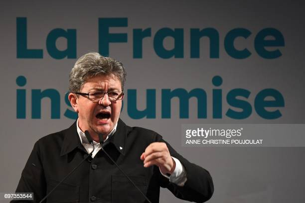 French farleft coalition La France Insoumise leader JeanLuc Melenchon gestures as he delivers a speech after the polls closed during the second round...