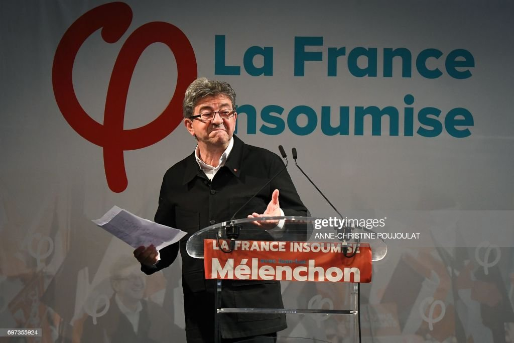 French far-left coalition La France Insoumise (LFI) leader Jean-Luc Melenchon reacts as he delivers a speech after the polls closed during the second round of the French parliamentary elections (elections legislatives in French) on June 18, 2017 in Marseille, southern France. Melenchon announces the creation of a future LFI Group at the French Assembly after beeing elected in the Bouches-du-Rhone following the results of the French parliamentary elections. President Emmanuel Macron's centrist party won a massive majority in parliamentary elections on June 18, 2017 early projections showed, dominating the country's traditional forces in a dramatic re-drawing of the political map. / AFP PHOTO / Anne-Christine POUJOULAT