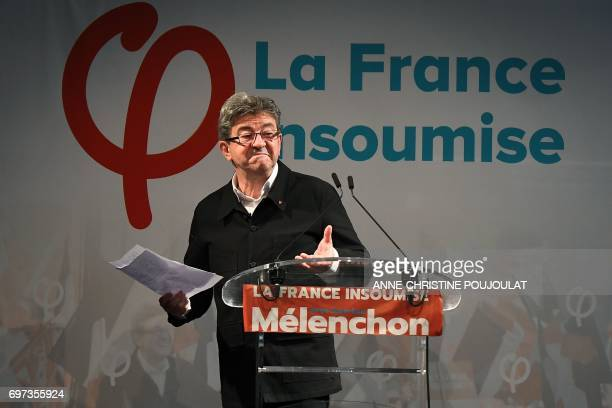 French farleft coalition La France Insoumise leader JeanLuc Melenchon reacts as he delivers a speech after the polls closed during the second round...