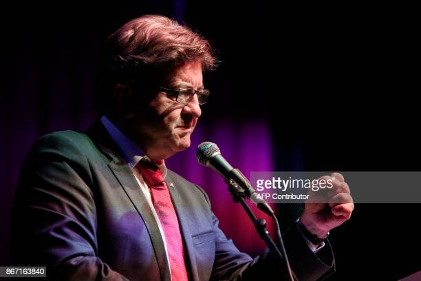 French farleft leader JeanLuc Melenchon gestures as he speaks during a conference organised by the leader of the Course of Freedom political party in...