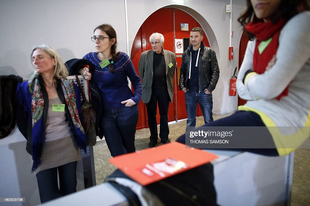 French far-left New Anti-Capitalist Party (NPA) members Alain Krivine (3rd L) and Olivier Besancenot (2nd R) attend the third NPA congress in Saint-Denis, north of Paris, on January 30, 2015. The NPA, which lost hundreds of members a year-and-a-half prior, gone to join the left-wing Front de Gauche coalition, will debate on various platforms proposing different directions for the party and elect a new leadership at the end of the congress on February 1. AFP PHOTO / THOMAS SAMSON