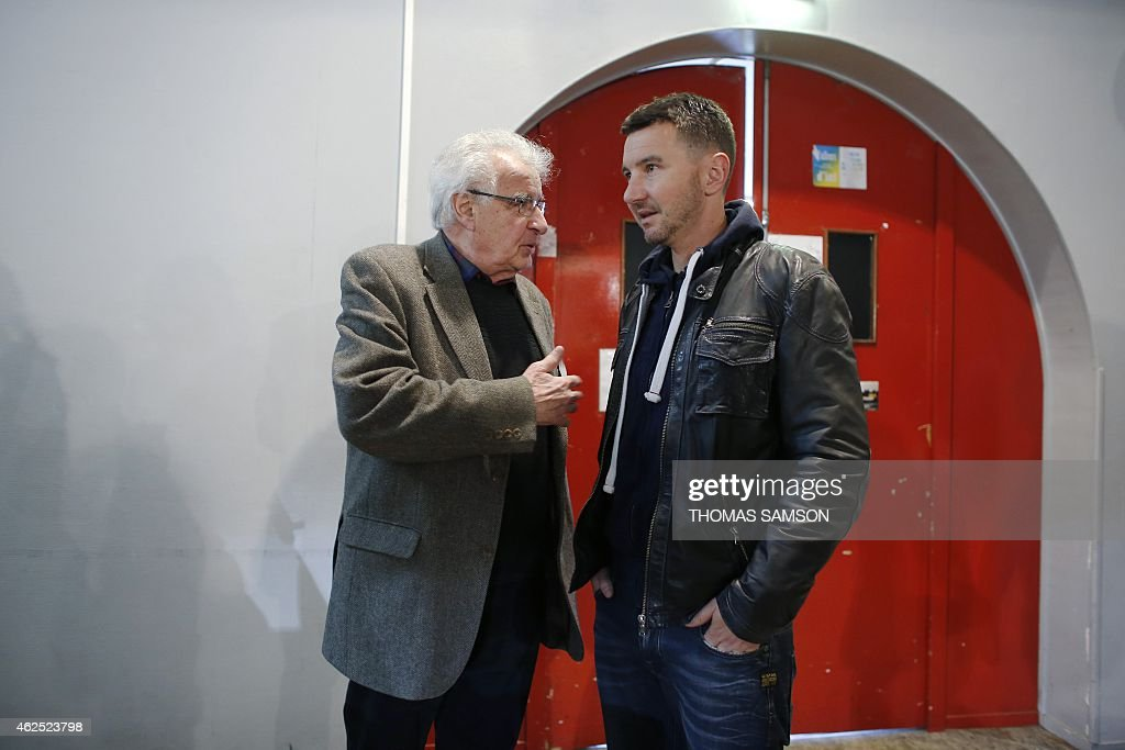 French far-left New Anti-Capitalist Party (NPA) members Alain Krivine (L) and <a gi-track='captionPersonalityLinkClicked' href=/galleries/search?phrase=Olivier+Besancenot&family=editorial&specificpeople=635113 ng-click='$event.stopPropagation()'>Olivier Besancenot</a> (R) attend the third NPA congress in Saint-Denis, north of Paris, on January 30, 2015. The NPA, which lost hundreds of members a year-and-a-half prior, gone to join the left-wing Front de Gauche coalition, will debate on various platforms proposing different directions for the party and elect a new leadership at the end of the congress on February 1.
