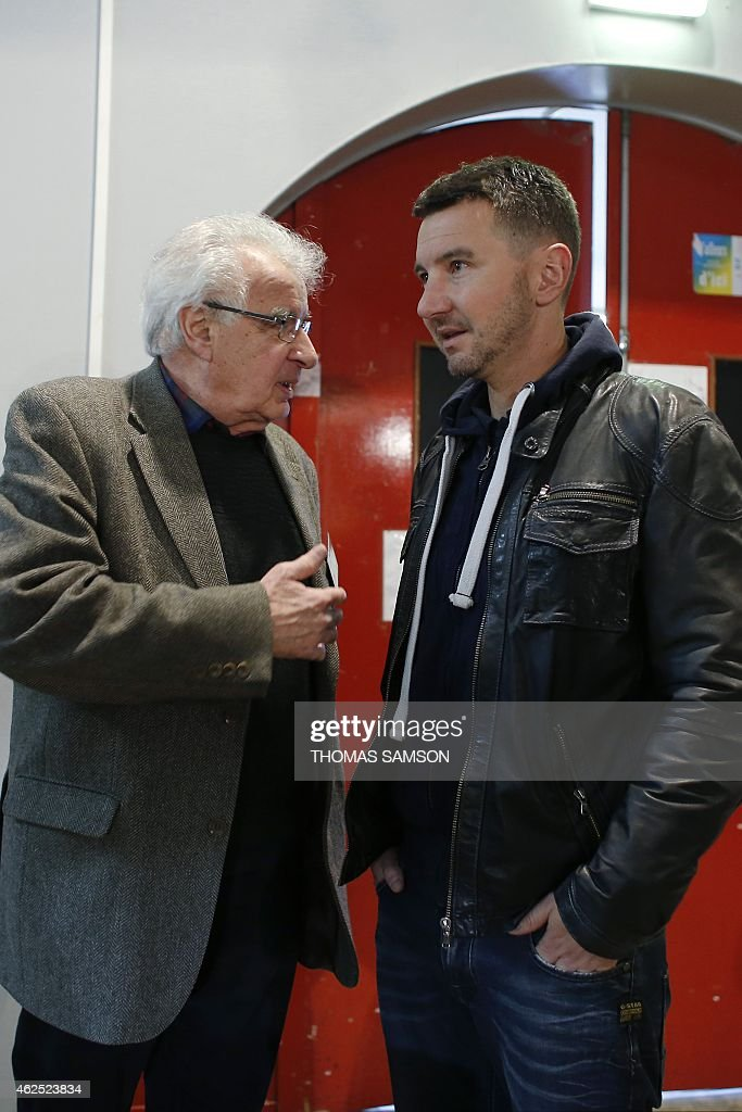 French far-left New Anti-Capitalist Party (NPA) members Alain Krivine (L) and Olivier Besancenot (R) attend the third NPA congress in Saint-Denis, north of Paris, on January 30, 2015. The NPA, which lost hundreds of members a year-and-a-half prior, gone to join the left-wing Front de Gauche coalition, will debate on various platforms proposing different directions for the party and elect a new leadership at the end of the congress on February 1. AFP PHOTO / THOMAS SAMSON