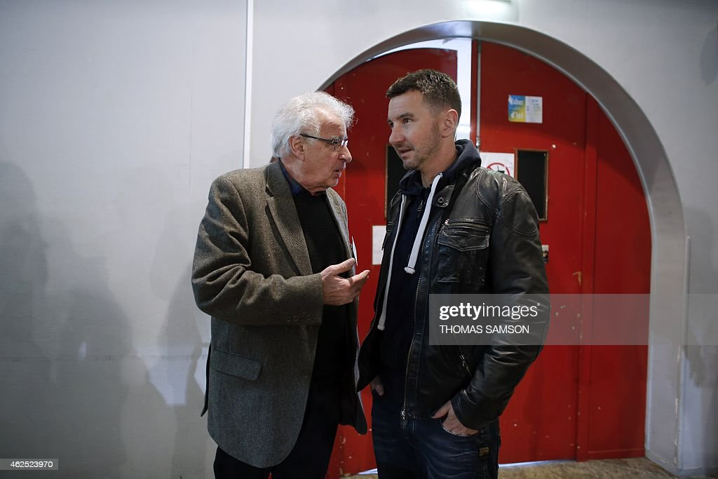 French far-left New Anti-Capitalist Party (NPA) members Alain Krivine (L) and Olivier Besancenot (R) talks during the third NPA congress in Saint-Denis, north of Paris, on January 30, 2015. The NPA, which lost hundreds of members a year-and-a-half prior, gone to join the left-wing Front de Gauche coalition, will debate on various platforms proposing different directions for the party and elect a new leadership at the end of the congress on February 1. AFP PHOTO / THOMAS SAMSON