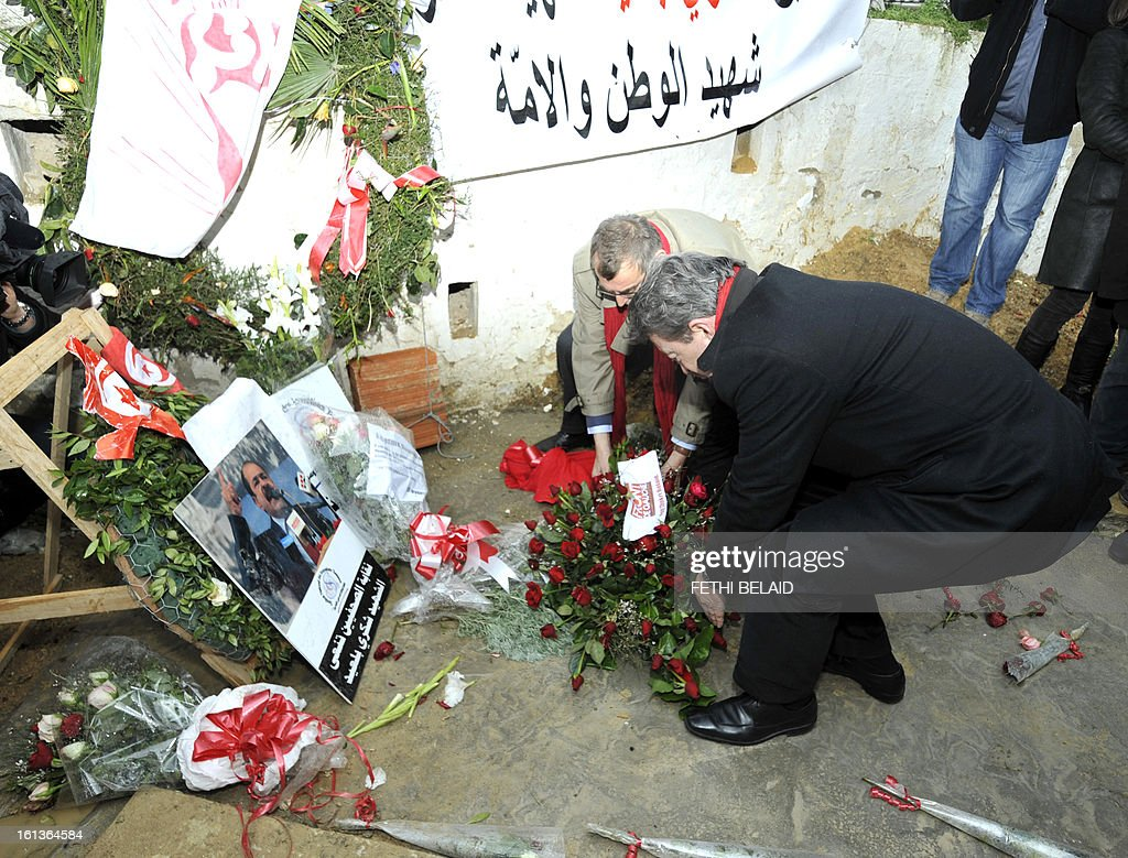 French far-left Parti de Gauche (PG) party leader, Jean-Luc Melenchon (R) lays flowers at the grave of assassinated opposition leader Chokri Belaid in the el-Jellaz cemetery, on February 10, 2013, in the capital Tunis. Tunisian Prime Minister Hamadi Jebali's gamble on forming a new government in defiance of his own Islamist party after the assassination of Belaid has left Tunisia in political limbo. AFP PHOTO / FETHI BELAID