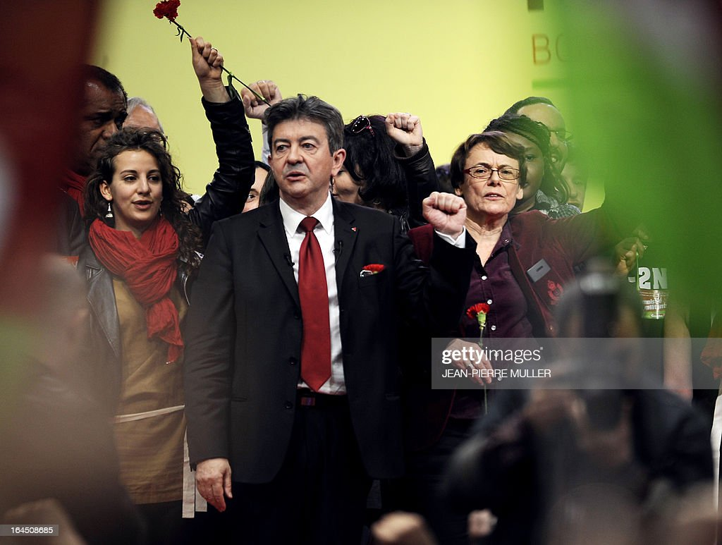 French far-left Parti de Gauche (PG) party leader, Jean-Luc Melenchon (L) next to his vice-president Martine Billard (R), sings the national anthem La Marseillaise at the end of the 3rd congress of the PG in Bordeaux on March 24, 2013.