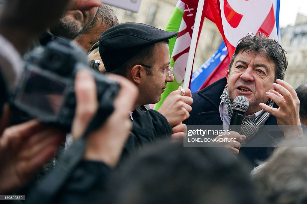 French far-left Parti de Gauche (PG) party's leader Jean-Luc Melenchon (R) gives a speech as he takes part with employees of the Virgin Megastore in a demonstration in front of the shop on the Champs-Elysees avenue, on January 29, 2013 in Paris. Megastore music and book unit direction, which is known in France as a 'culture' retailer, annouced two weeks ago its insolvency. Originally started by Richard Branson, the British billionaire and chairman of the Virgin Group, the Virgin megastores were bought by the French Lagardere group in 2001 before French-American businessman Walter Butler became the majority shareholder. Butler announced on January 20, 2013, its failure to relaunch the stores.