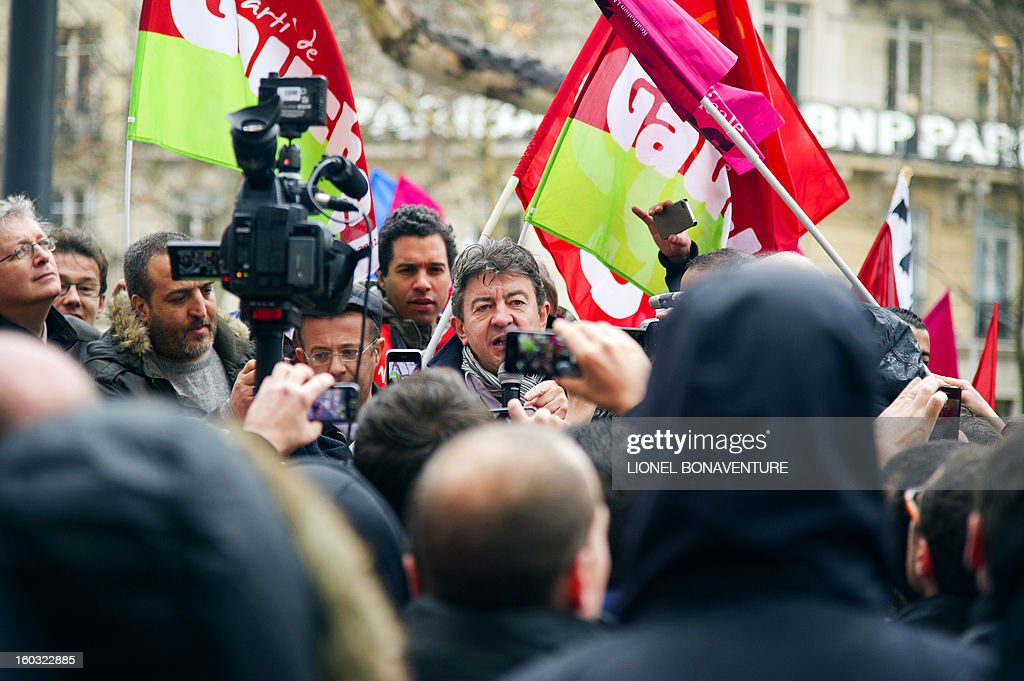 French far-left Parti de Gauche (PG) party's leader Jean-Luc Melenchon (C) gives a speech as he takes part with employees of the Virgin Megastore in a demonstration in front of the shop on the Champs-Elysees avenue, on January 29, 2013 in Paris. Megastore music and book unit direction, which is known in France as a 'culture' retailer, annouced two weeks ago its insolvency. Originally started by Richard Branson, the British billionaire and chairman of the Virgin Group, the Virgin megastores were bought by the French Lagardere group in 2001 before French-American businessman Walter Butler became the majority shareholder. Butler announced on January 20, 2013, its failure to relaunch the stores.