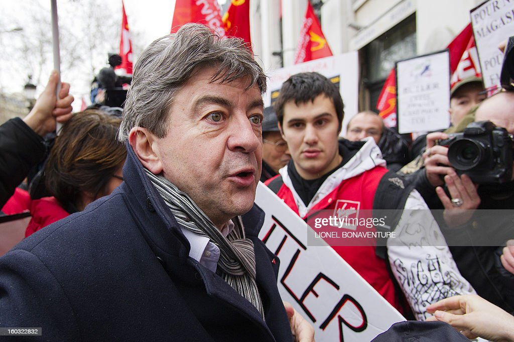 French far-left Parti de Gauche (PG) party's leader Jean-Luc Melenchon takes part with employees of the Virgin Megastore in a demonstration in front of the shop on the Champs-Elysees avenue, on January 29, 2013 in Paris. Megastore music and book unit, which is known in France as a 'culture' retailer, said two weeks ago it will file for insolvency. Originally started by Richard Branson, the British billionaire and chairman of the Virgin Group, the Virgin megastores were bought by the French Lagardere group in 2001 before French-American businessman Walter Butler became the majority shareholder. Butler announced on January 20, 2013, its failure to relaunch the stores. AFP PHOTO / LIONEL BONAVENTURE