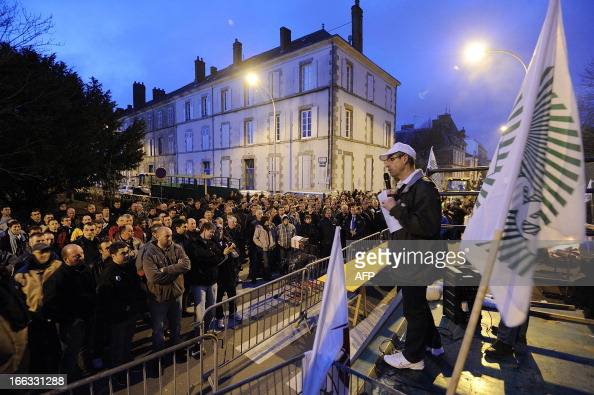 A French farmer and local member of the farmers' union FDSEA speaks during a demonstration called by the union to demand higher wages on April 11...