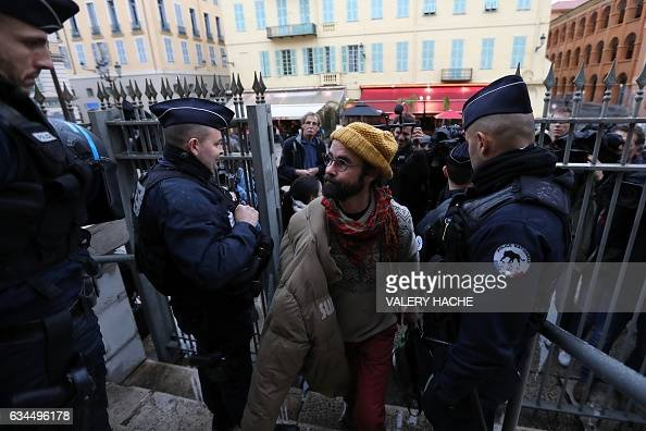 French farmer Cedric Herrou arrives at the Nice court house on February 10 for his trial for illegally assisting migrants Herrou who has become one...