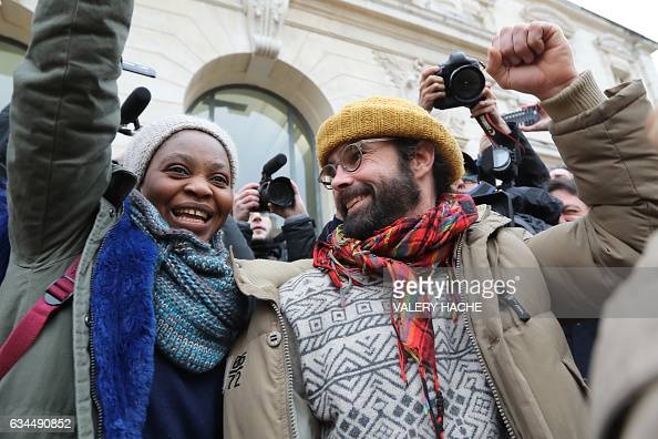 French farmer Cedric Herrou gestures next to a Malian woman named Khadidja as he leaves the Nice court house on February 10 after his trial for...
