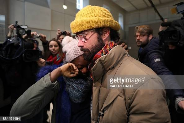 French farmer Cedric Herrou hugs a Malian woman named Khadidja as he leaves the Nice court house on February 10 after his trial for illegally...