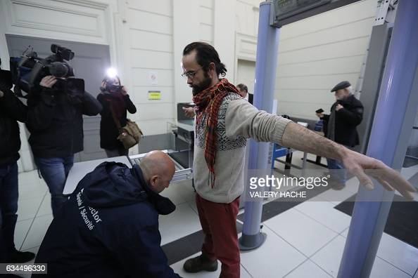 French farmer Cedric Herrou is checked with a metal detector as arrives at the Nice court house on February 10 for his trial for illegally assisting...