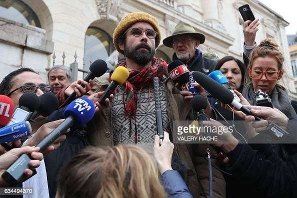 French farmer Cedric Herrou speaks to journalists as he leaves the Nice court house on February 10 after his trial for illegally assisting migrants...