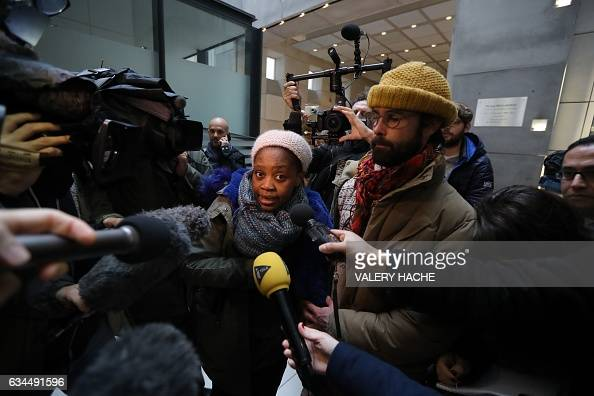 French farmer Cedric Herrou stands next to a Malian woman named Khadidja as she speaks to journalists on their way out of the Nice court house on...