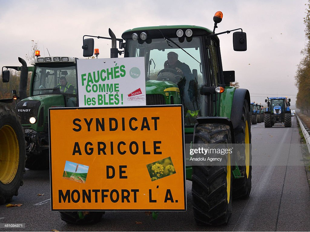 French farmers blocked highways in protest against new government taxes by pulling tractors on to the road on November 21, 2013 in Paris, France. Anti-tax protests have been staged across France in the past weeks, especially over a plan for a new levy on road freight.