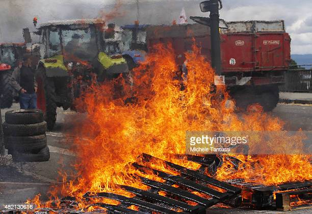 French farmers burn wood and use tractors and tyres to form a blockade at the Europe bridge leading over the Rhine between Strasbourg and Kehl on the...