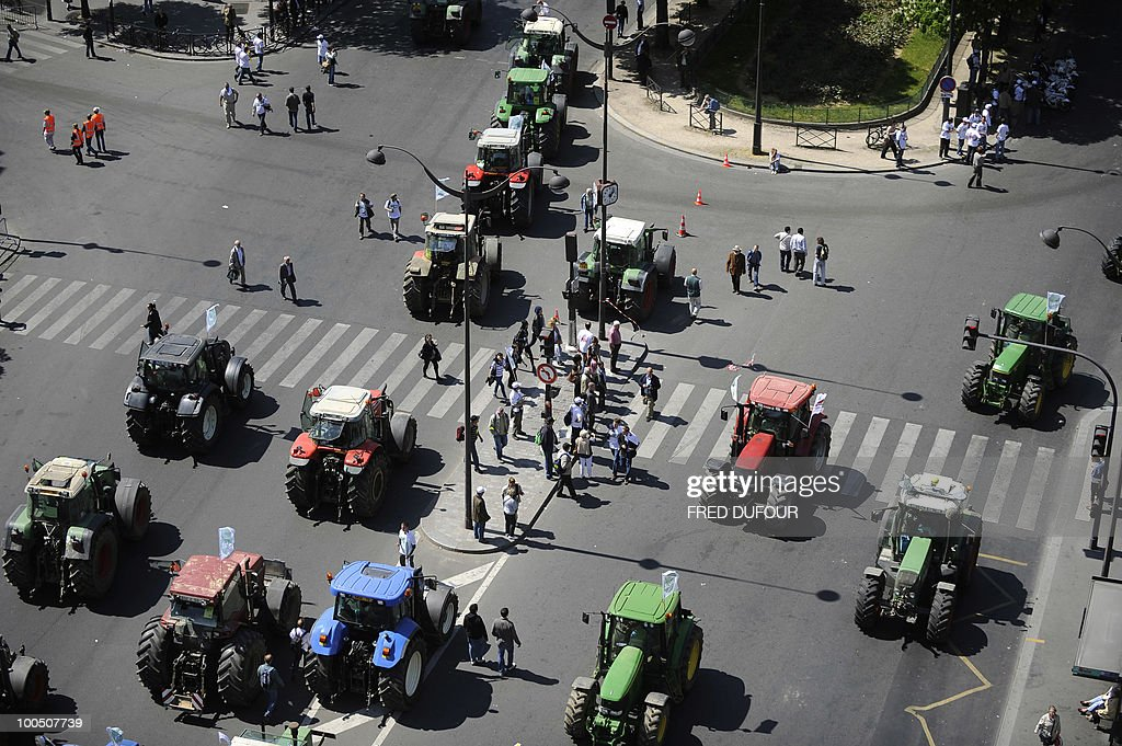 French farmers demonstrate with their tractors on April 27, 2010 in Paris to protest against wages cut and to denounce the European Farm Policy. The demonstration headed by grain farmers was called by 14 regional unions and backed by the National Farmers union (FNSEA).