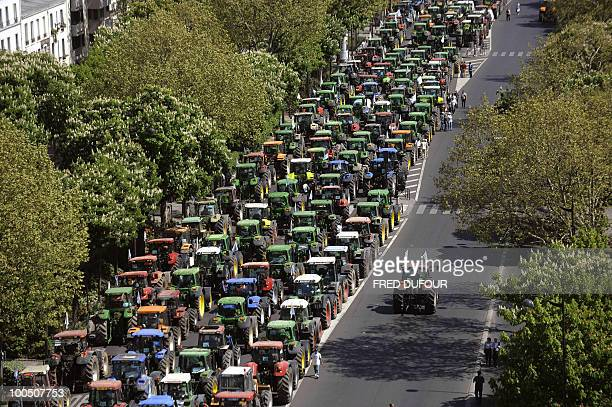 French farmers demonstrate with their tractors on April 27 2010 in Paris to protest against wages cut and to denounce the European Farm Policy The...