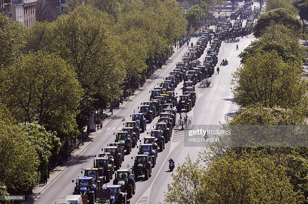 French farmers drive their tractors in Paris on April 27, 2010 before demonstrating against wages cut and to denounce the European Farm Policy. The demonstration headed by grain farmers was called by 14 regional unions and backed by the National Farmers union (FNSEA).