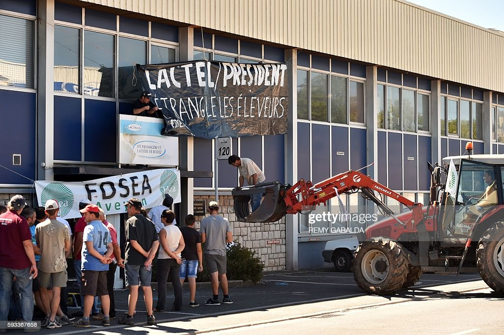 French farmers hang a banner reading 'Lactel / President strangles the farmers' on the frontage of of a factory of the French group Lactalis on...